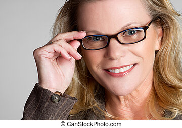 Woman Wearing Glasses - Beautiful middle aged woman wearing...