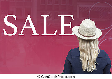 Woman in front of shop window