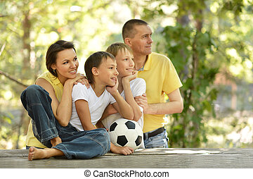 family and socker ball - Portrait of a happy family and...
