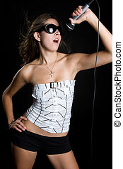 Singing Girl - Pretty girl singing into microphone