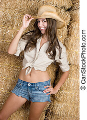 Country Girl - Smiling country girl in hay
