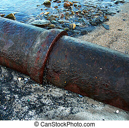 Waste Water pipe - waste water pipe on seaside beach...