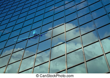 airplane reflect on building glass