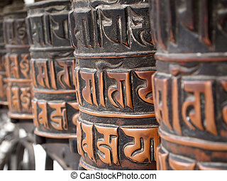 Prayer wheels - Decorated buddhist prayer wheels in a stupa...