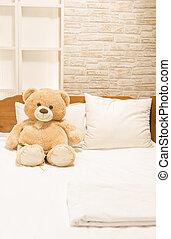 Teddy bear toy sitting on the bed - Teddy bear toy sitting...