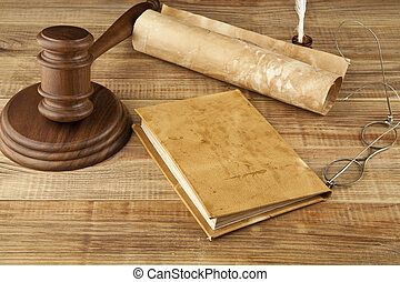 books and wooden gavel on wooden background