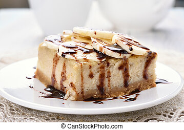 Dessert banana cheese cake, covered with chocolate sauce and...