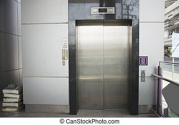Lift or escalator for person disabled for moving up and down...