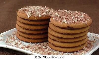 Round cookies with chocolate in a plate