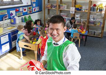Portrait of a Teacher - Teacher in a classroom. He is...