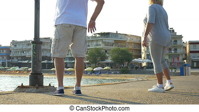 People Doing Morning Exercises - Man and woman are doing...