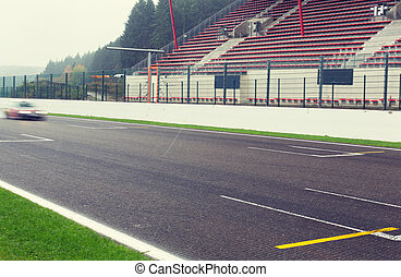 close up of car driving on speedway track or road