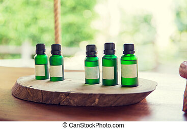 close up of aromatic oil bottles set at hotel room - beauty,...