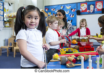 Noisy Nursery Lesson - Nursery children playing with musical...