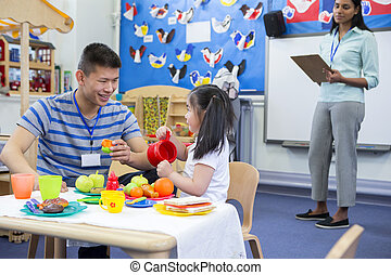 Roleplay Kitchen at Nursery - Male teacher playing in a toy...