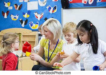 Do you take sugar? - Nursery teacher playing kitchen...