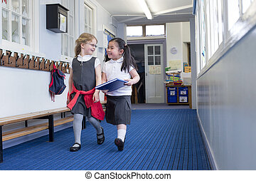 Two Girls Walking to Lesson - Two female nursery students...