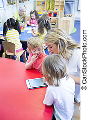Education through technology - Female teacher using a...