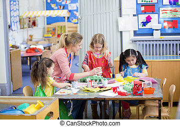 Arts and Crafts at Nursery - Teacher and nursery students...