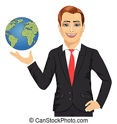 Young businessman holding globe in his hand