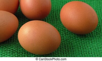 Fresh raw group of eggs put on green sack