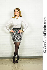 Portrait of smiling young businesswoman, posing at studio.