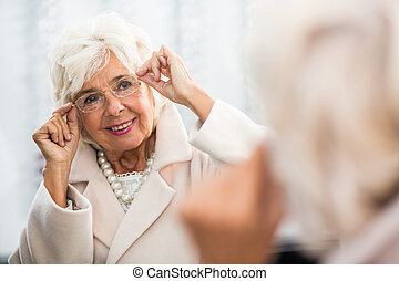 Fancy grandmother looking for her perfect glasses - Very...