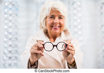 Shape and colour that best suits her smiling face - Elderly...
