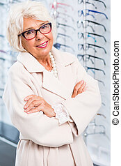 Smart glasses for elegant elderly woman - Portrait of an...