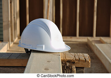 Hard Hat on Board at Construction Site