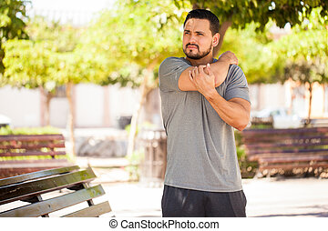 Man stretching and getting ready for exercising - Young man...