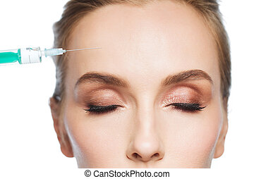 woman face and syringe making injection - people,...