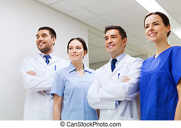 group of happy medics or doctors at hospital - clinic,...
