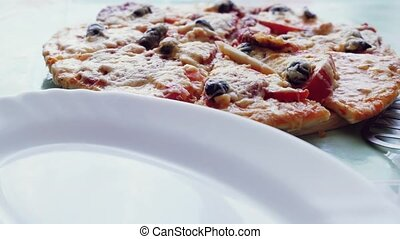 put freshly baked pizza in the plate. 1920x1080. hd