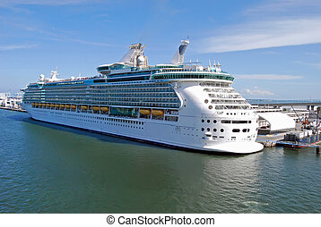 Cruise Ship - Cruise ship loading passengers at the port of...