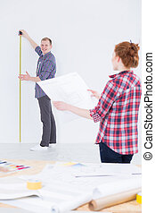 Redecorating is fun - Shot of a young couple renovating...