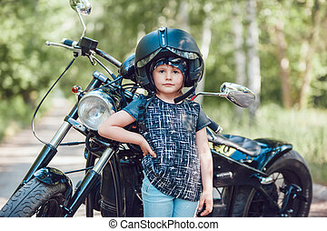 Little girl on a motorcycle. - Little beautiful girl in a...