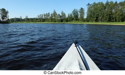 The view from the nose floating on the lake fishing kayaks