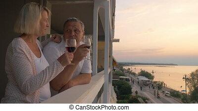 People having wine and enjoying sunset