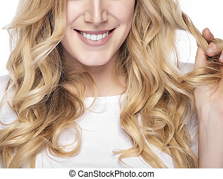 Blonde smiling woman on white background - Part of face...