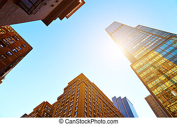 Looking up at skyscrapers in New York City - Looking up at...