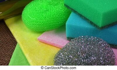 Colorful sponges for washing - Container with liquid for...