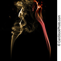 Yellow and red light smoke on a dark background - Abstract...