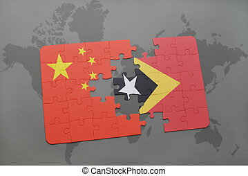 puzzle with the national flag of china and east timor on a world map background.