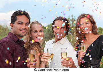 group champagne toast at party or wedding