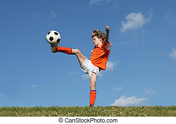 kid playing football or soccer