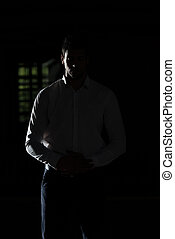 Muslim Man Praying In Dark Room