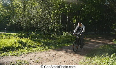 man riding bicycle outdoors - fitness, sport, people and...