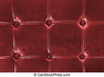 red tufted leather upholstery - Close up of rich red tufted...