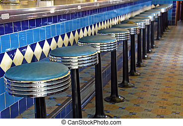 retro diner with row of stools - Chrome and blue leather...